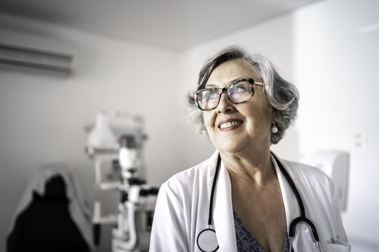 Senior female doctor dreaming / contemplation at hospital